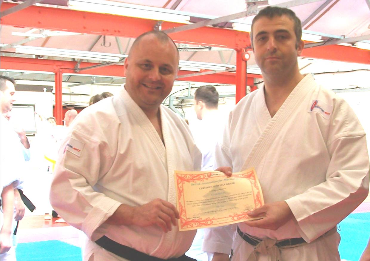 surprised John Burke sensei gets his 5th Dan awarde by Anthony Blades renshi